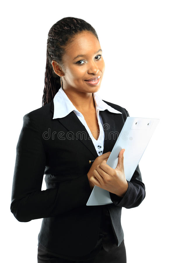 Young american african business woman with clipboard. Portrait of an attractive young american african business woman with clipboard stock photo