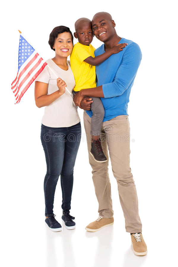 Young american family. Portrait of young american family with usa flag isolated on white stock photo