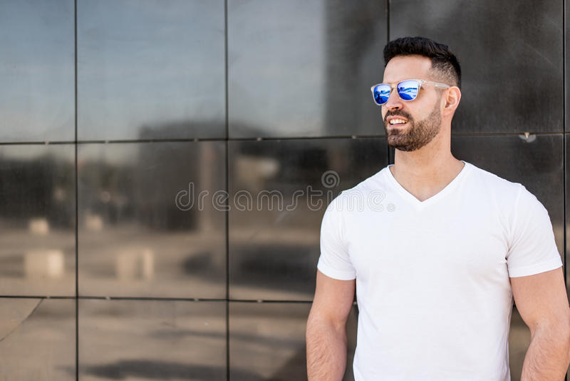Young american man smiling happy with sunglasses portrait outdoor.  stock photography