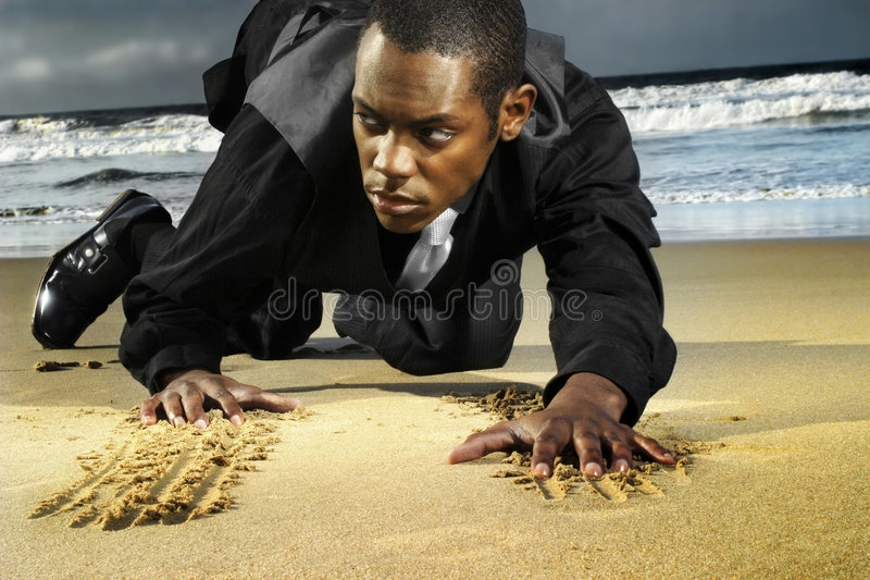 Young amn on beach crawling