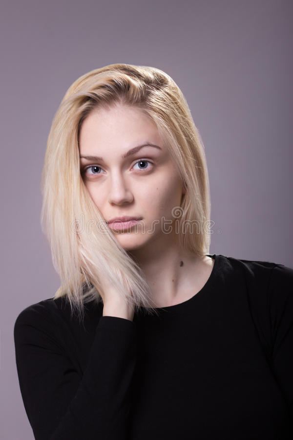 Young androgynous girl fashion model looking at camera royalty free stock photo
