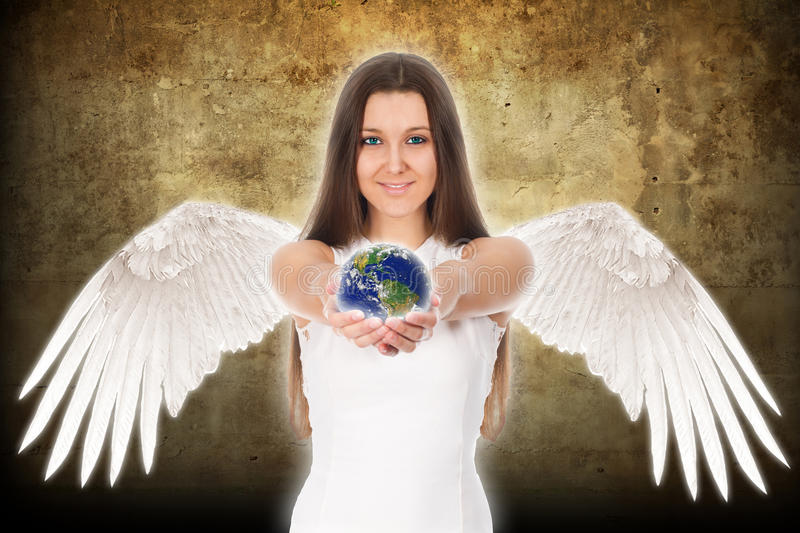 Young angel woman holding Earth in hands stock images
