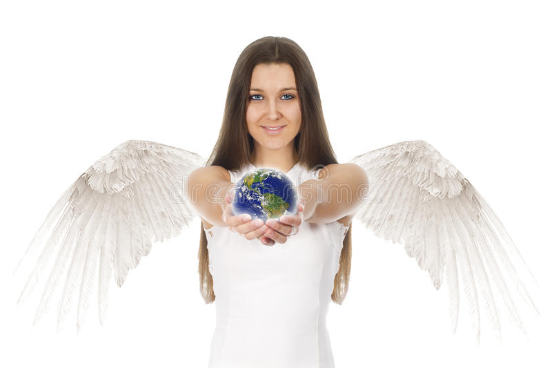 Young angel woman holding Earth in hands in white back stock photography