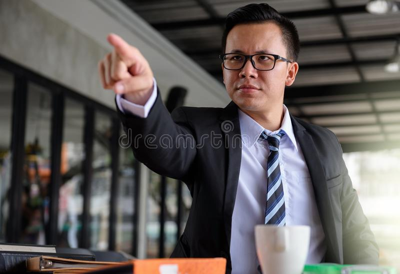Angry Businessman point his finger royalty free stock photo