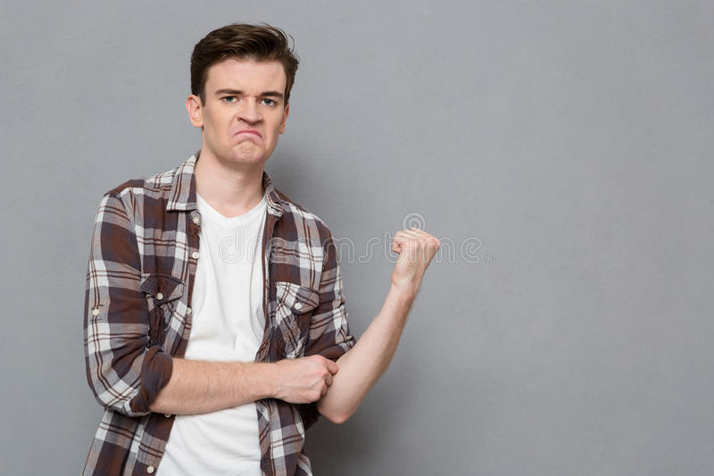 Young angry man showing fist royalty free stock photos