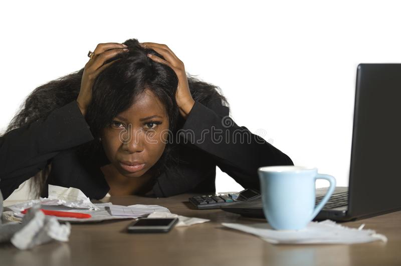 Young angry and upset black African American business woman working in stress at office computer desk feeling desperate and exhaus stock photo