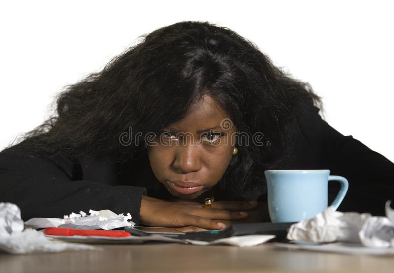 Young angry and upset black African American business woman working in stress at office computer desk feeling desperate and exhaus. Ted looking burnt and stock image