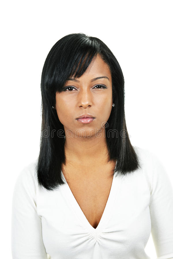 Young angry woman. Angry black woman portrait isolated on white background stock image