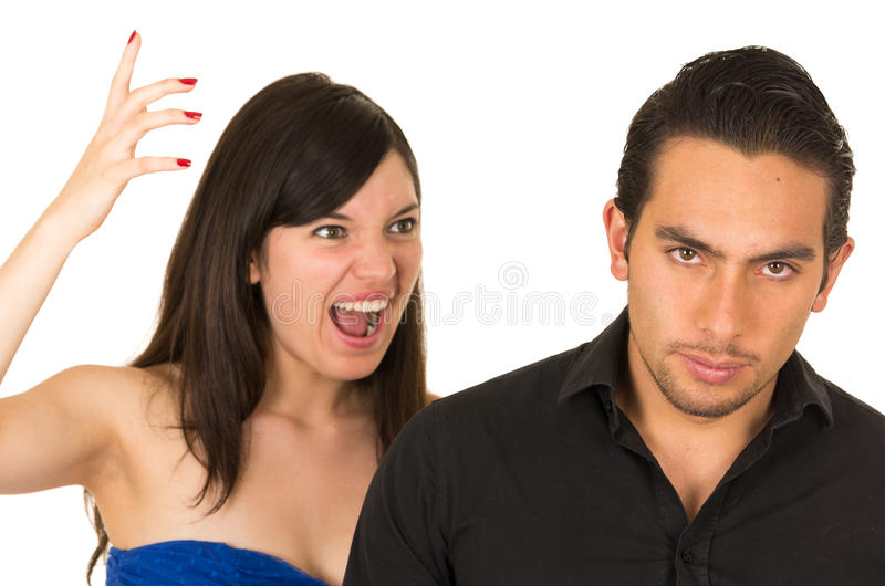 Young angry woman screaming at boyfriend husband. Young angry women screaming at boyfriend husband isolated on white royalty free stock images