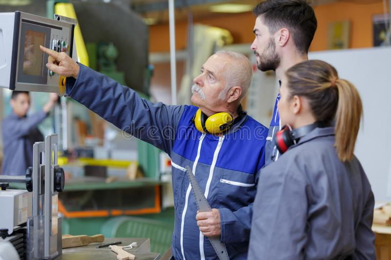 Young apprentices in industry sector royalty free stock image