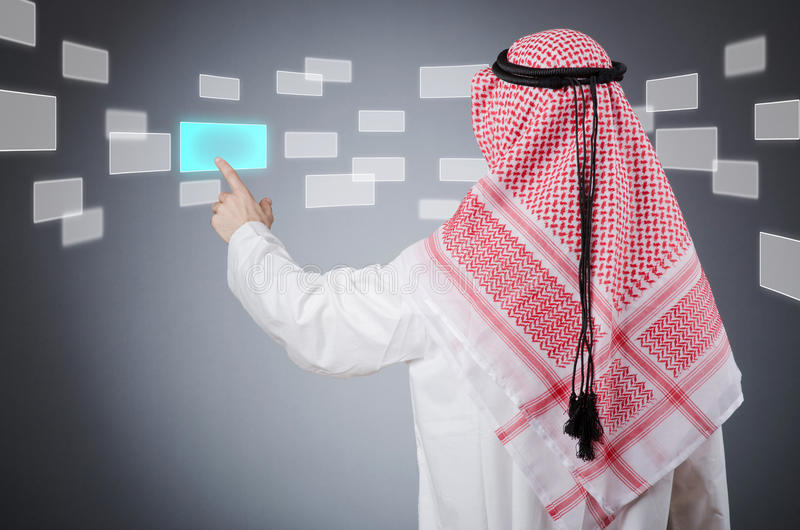 Download Young Arab Pressing Virtual Buttons Stock Photo - Image: 24568016