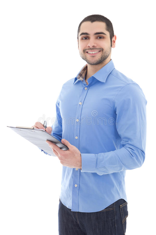 Young arabic man writing something on clipboard isolated on whit stock images