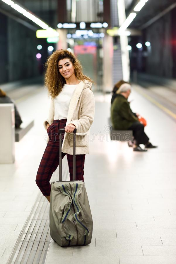Young arabic woman waiting her train in a subway station. stock photography