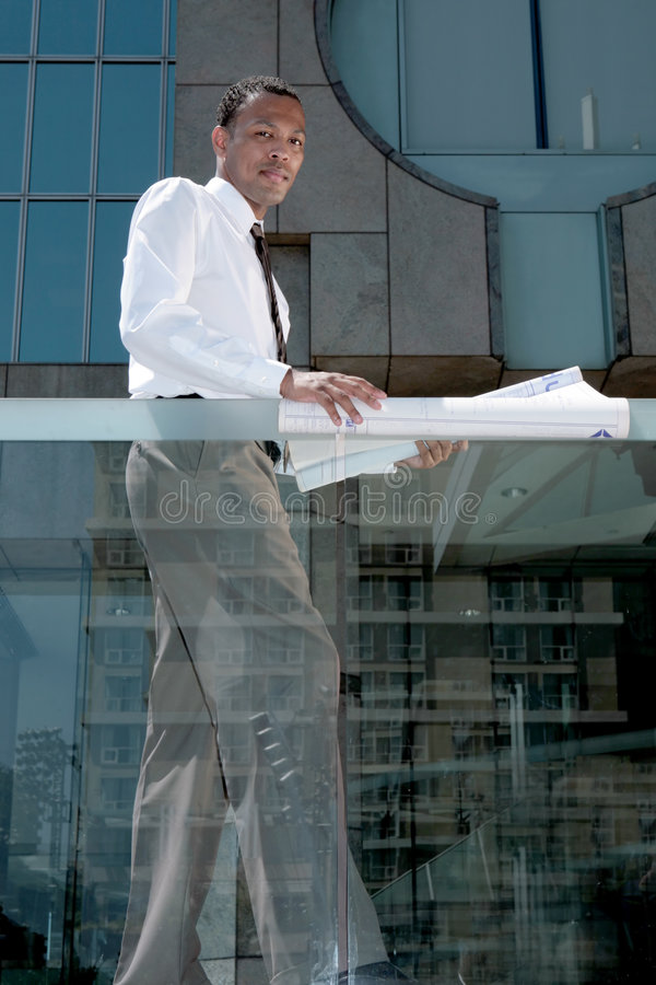 Download Young Architect Going Over Plans Stock Photos - Image: 8903513
