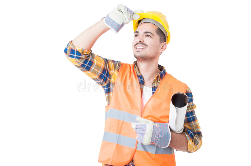 Young architect with paper roll under his arm acting joyful stock photography