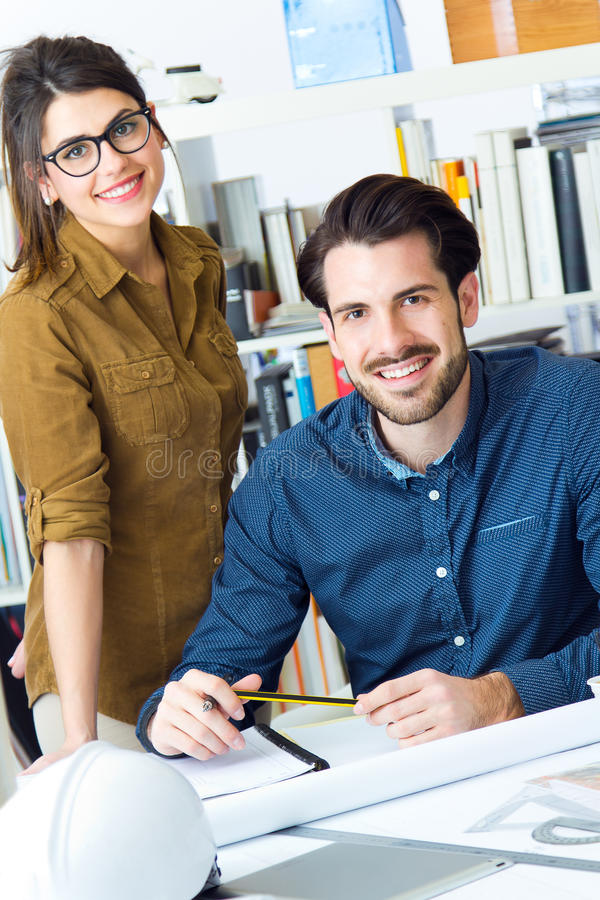 Young architect team working at office royalty free stock image