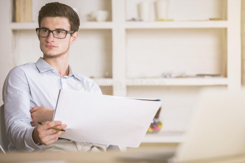 Young architect thinking about something stock images