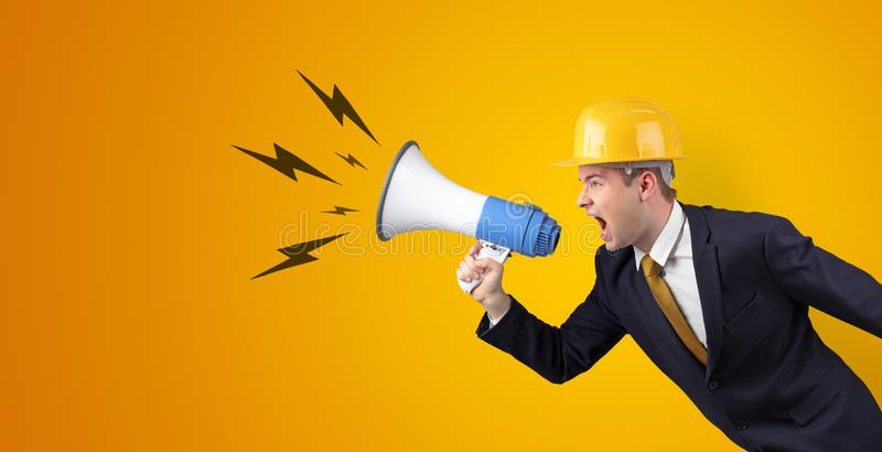 Young architect yelling with megaphone stock photos