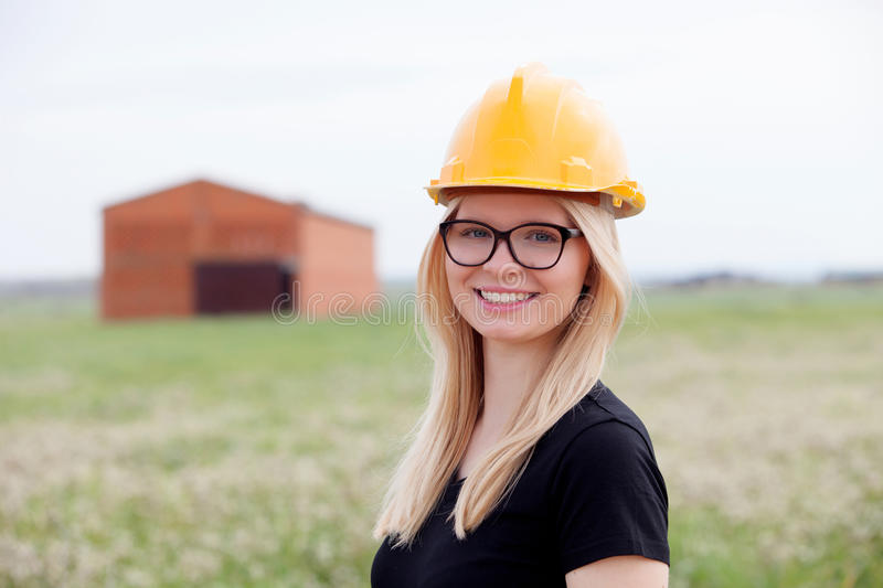 Young architect with yellow helmet royalty free stock image