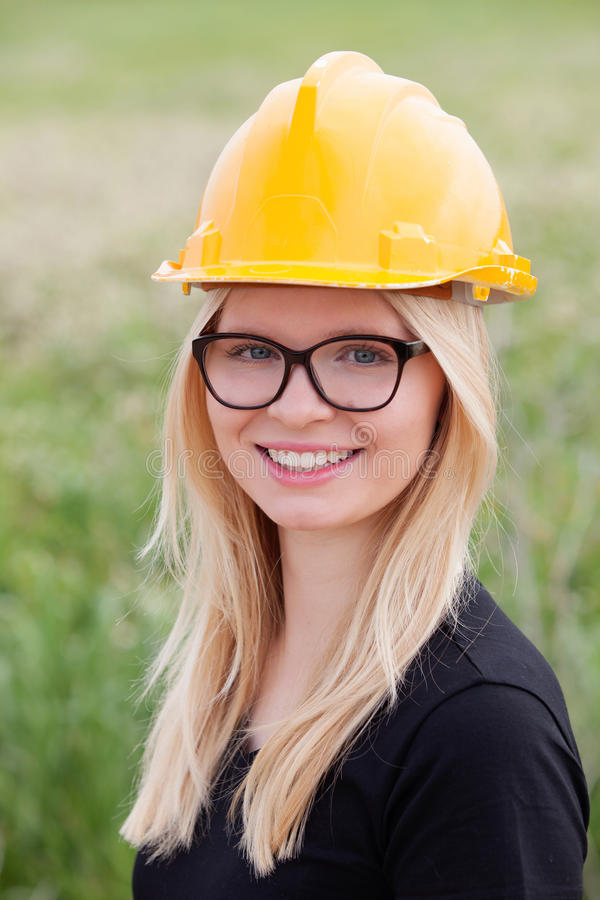 Young architect with yellow helmet stock image