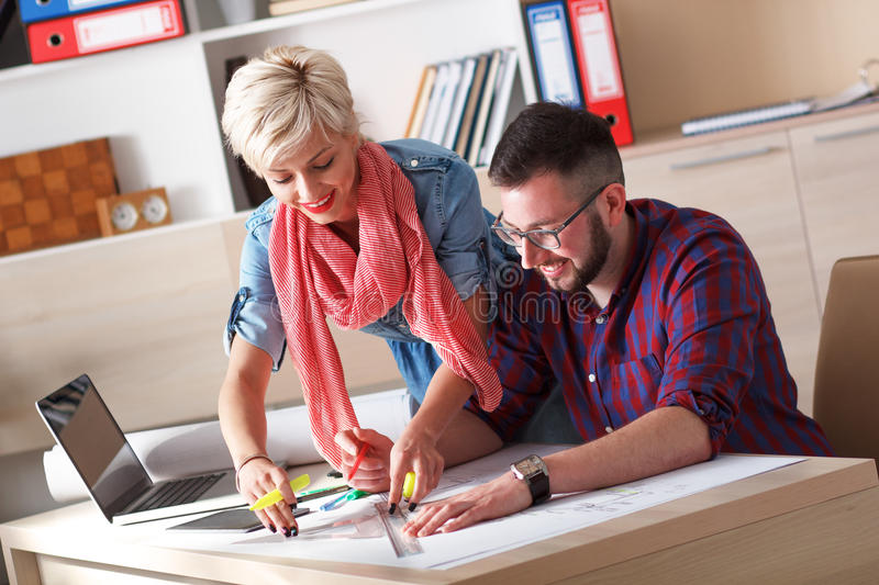 Young architects working on new project in office.  stock image