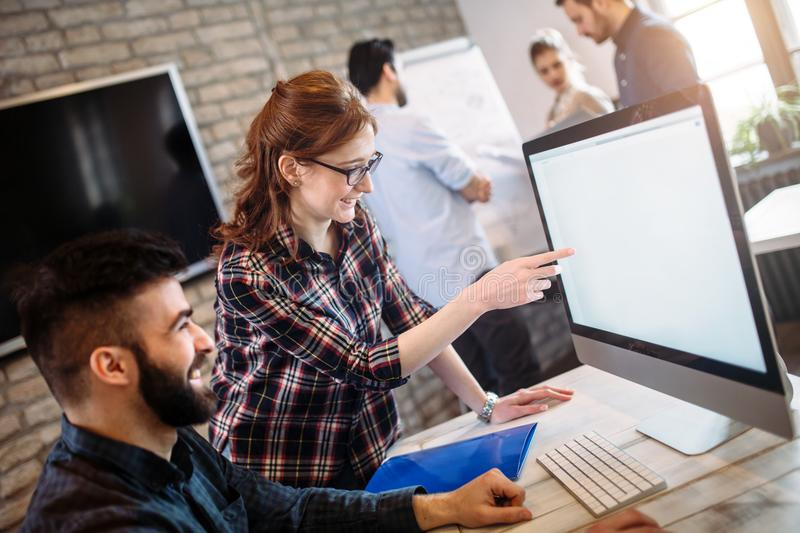 Young architects working on project in office royalty free stock images
