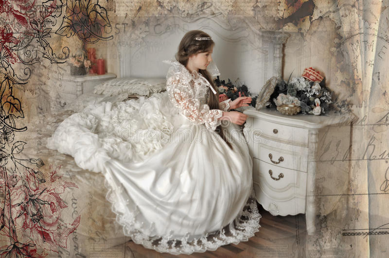 Young aristocrat sitting. Princess in a white dress retro child royalty free stock photo