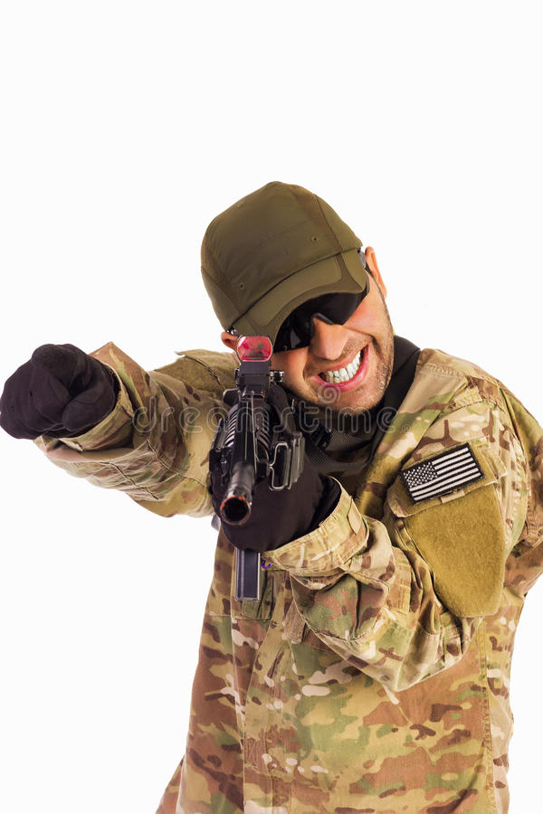 Young army soldier assaulting position royalty free stock photo