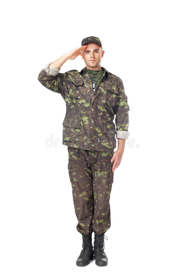 Young army soldier saluting. Full length portrait of young army soldier saluting isolated on white background stock image