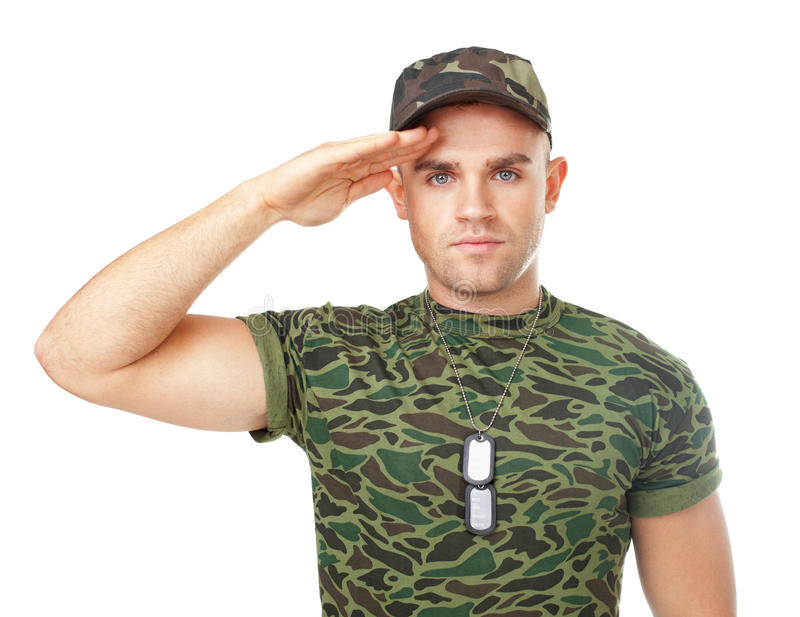 Young army soldier saluting. Full length portrait of young army soldier saluting isolated on white background stock images