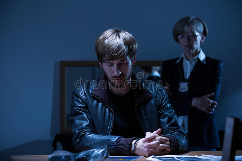 Young arrested man royalty free stock image