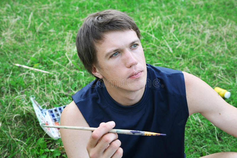 Download Young Artist With The Brush Stock Photo - Image of relax, thinking: 10135286