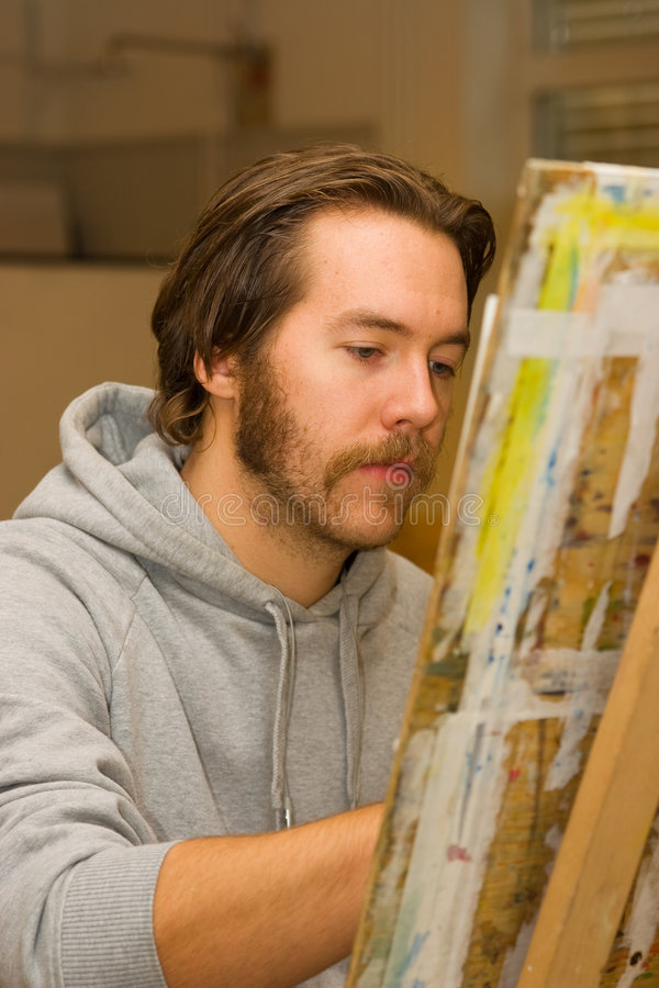 Young artist drawing royalty free stock image