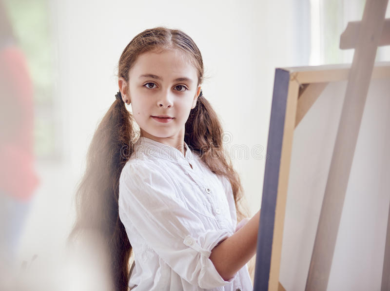 Young artist girl painting stock photo
