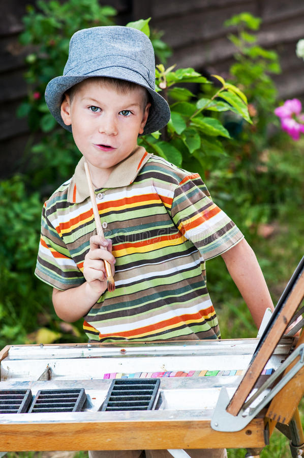 Young artist starting his work stock photos