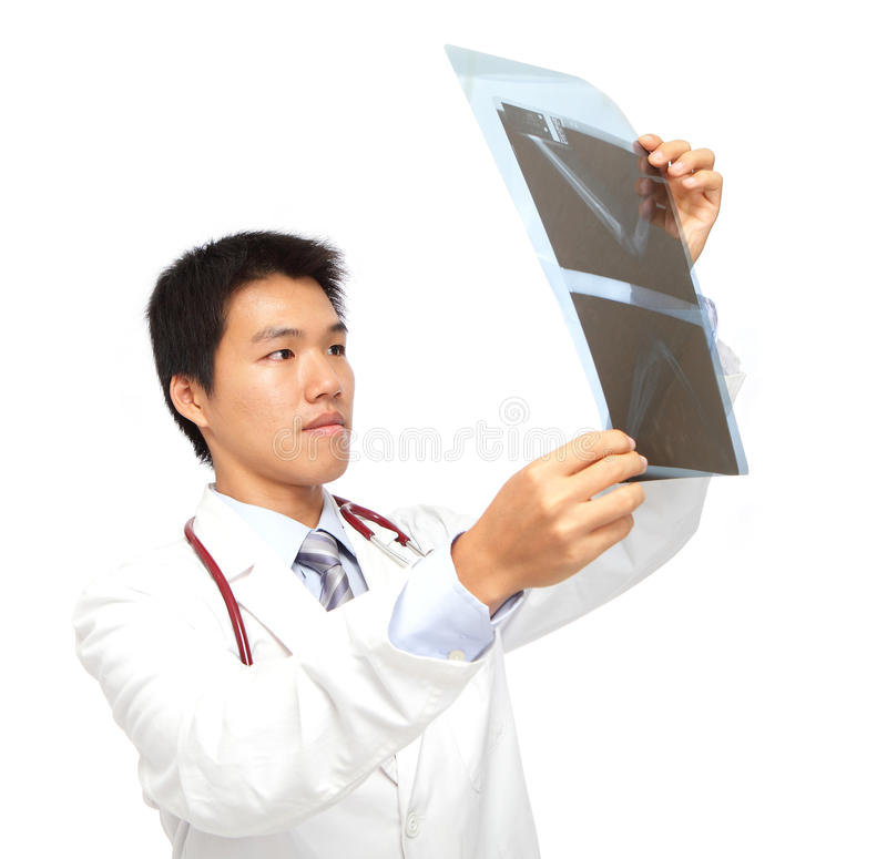 Young asia doctor check x-ray stock photography