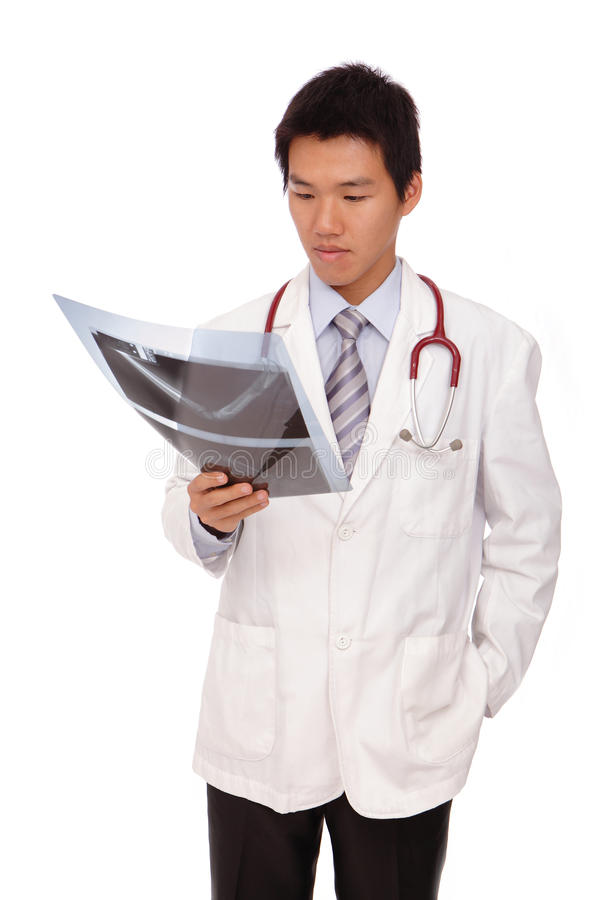 Young asia doctor checking x-ray stock photos
