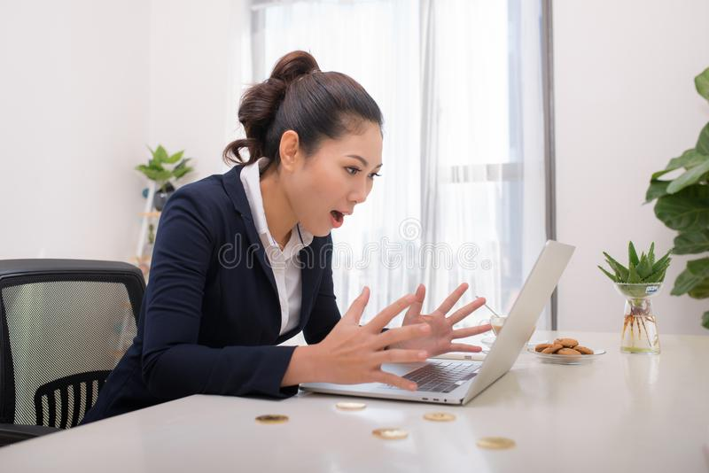 Young Asia modern successful business woman with Computer and bi stock images