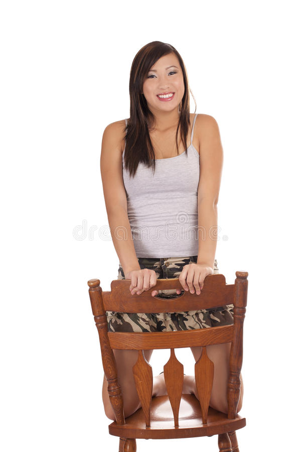 Young Asian American Teen Girl Kneeling On Chair Stock -5501