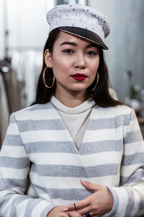 Young asian beaming woman with red lipstick looking contented stock photos