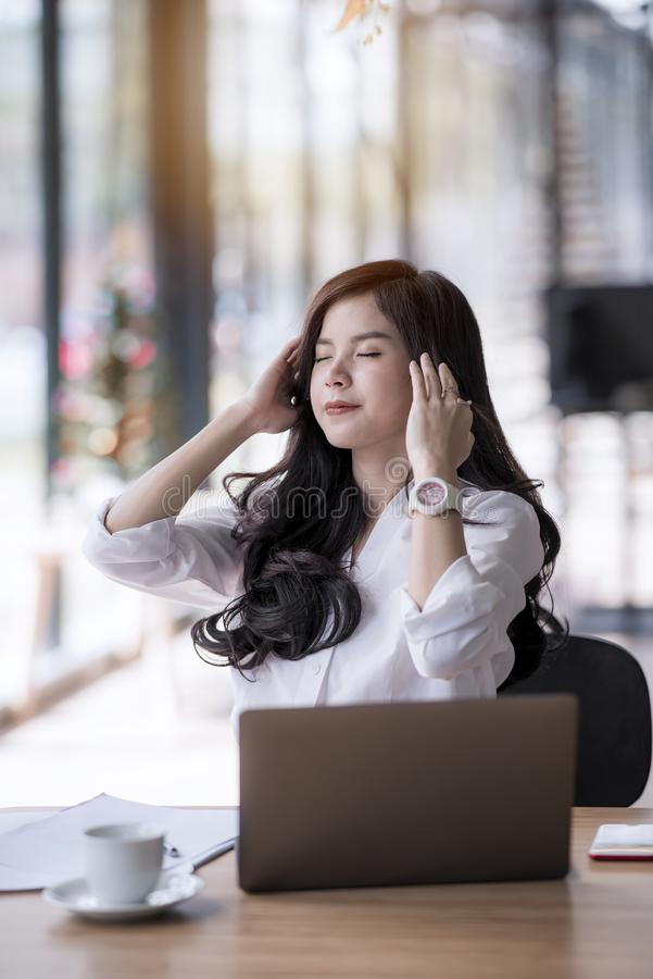 Young asian beautiful businesswoman being be fatigued stock image