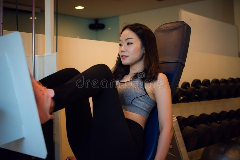 Young Asian beautiful woman is exercising royalty free stock image