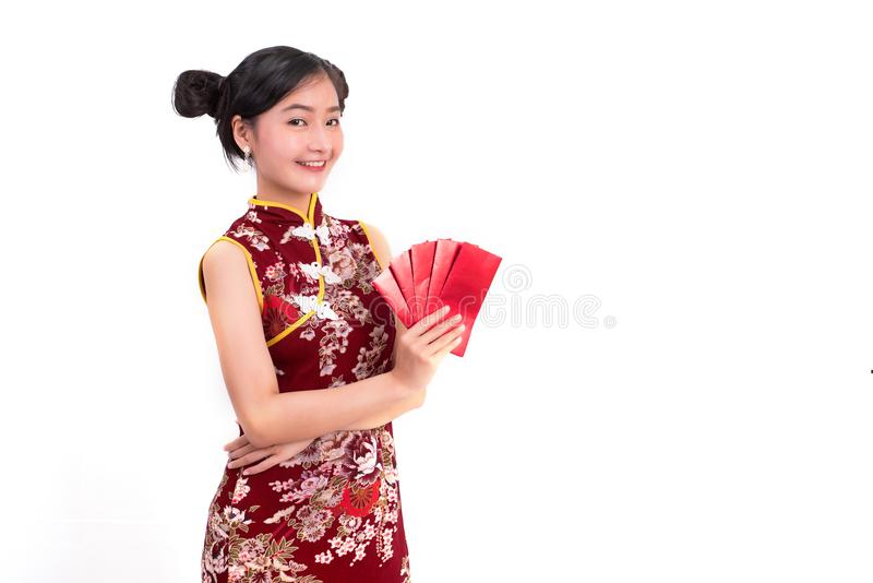 Young Asian beauty woman wearing cheongsam and holding packet of royalty free stock images