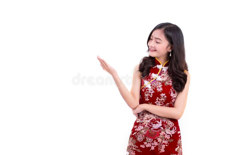 Young Asian beauty woman wearing cheongsam and presenting with hands gesture in Chinese new year festival event on isolated white. Background. Holiday and stock photos