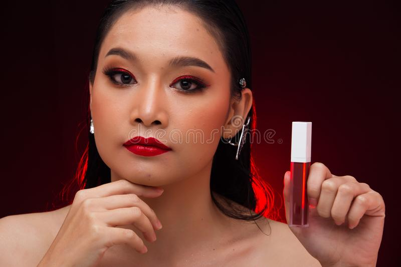 Young Asian black hair fur woman fire red screen stock photo