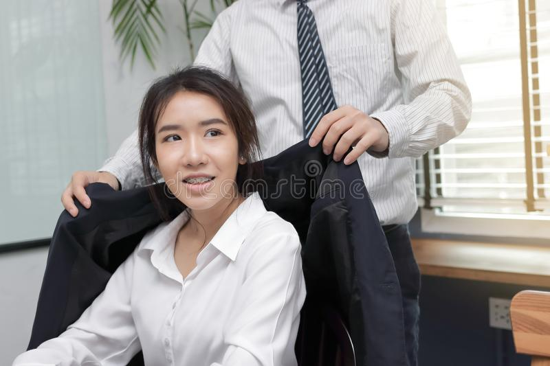Young Asian boss taking care employee woman in office. royalty free stock photos