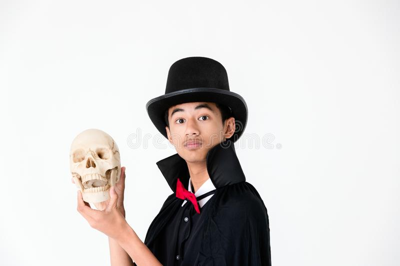 Young Asian boy in black cover and black hat holding and looking stock photos