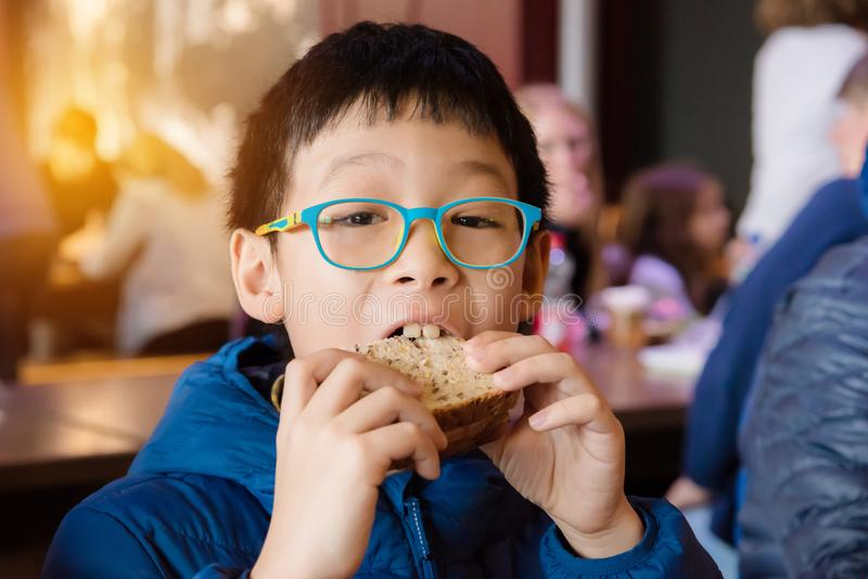 Boy eating sandwich for lunch stock photo