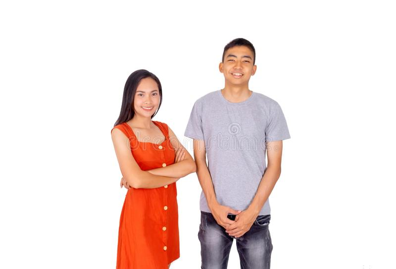 Young Asian boy and girl standing together in front of the camera white background. The Young Asian boy and girl standing together in front of the camera white royalty free stock photography