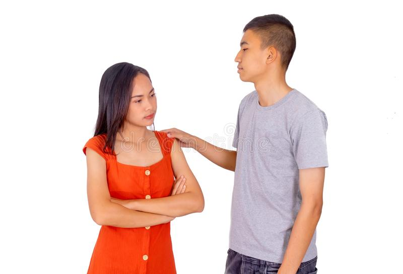 Young Asian boy and girl standing together in front of the camera white background. The Young Asian boy and girl standing together in front of the camera white royalty free stock images